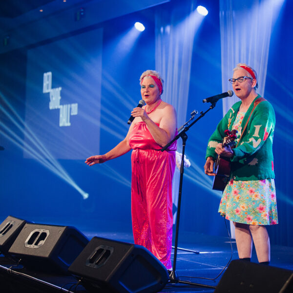 The Topp Twins as Camp Mother and Camp Leader performing at the 2018 Red Shoe Ball at the Langham Hotel in Auckland, New Zealand. This annual charity event was photographed by Auckland event photographer Mala Photography