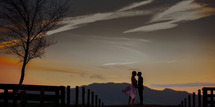 A Bride and Groom photographed during sunset at The Red Barn - a wedding venue in Waikato, New Zealand.