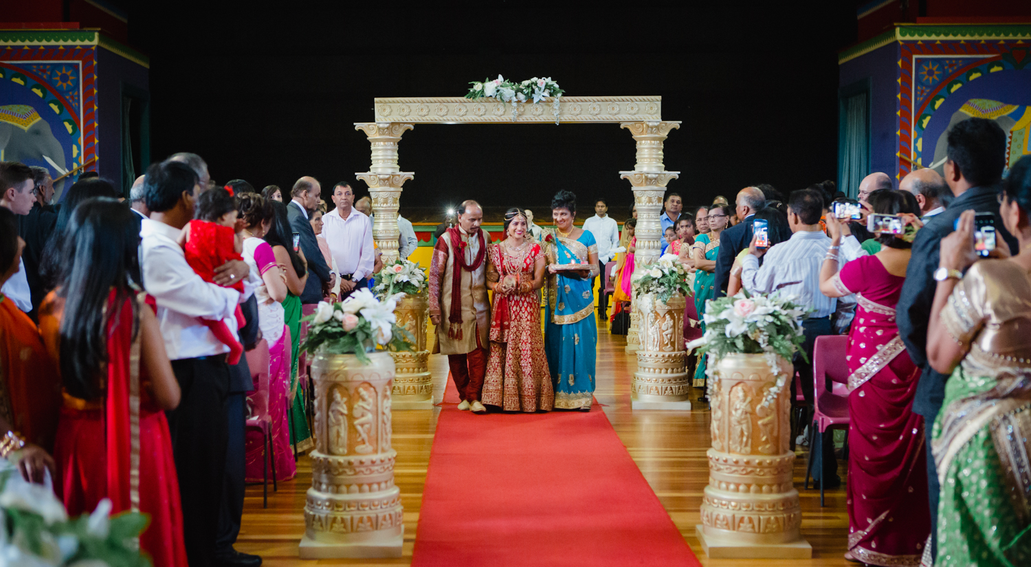 A traditional Indian Bride arriving at her Hindu wedding ceremony at the Auckland Indian Association Hall in Kilbirnie, Wellington. Photographed by Mala Photography, an Auckland based wedding photographer that has a lot of experience photographing Indian weddings in Auckland, Wellington, Hamilton, Queenstown and New Zealand wide.
