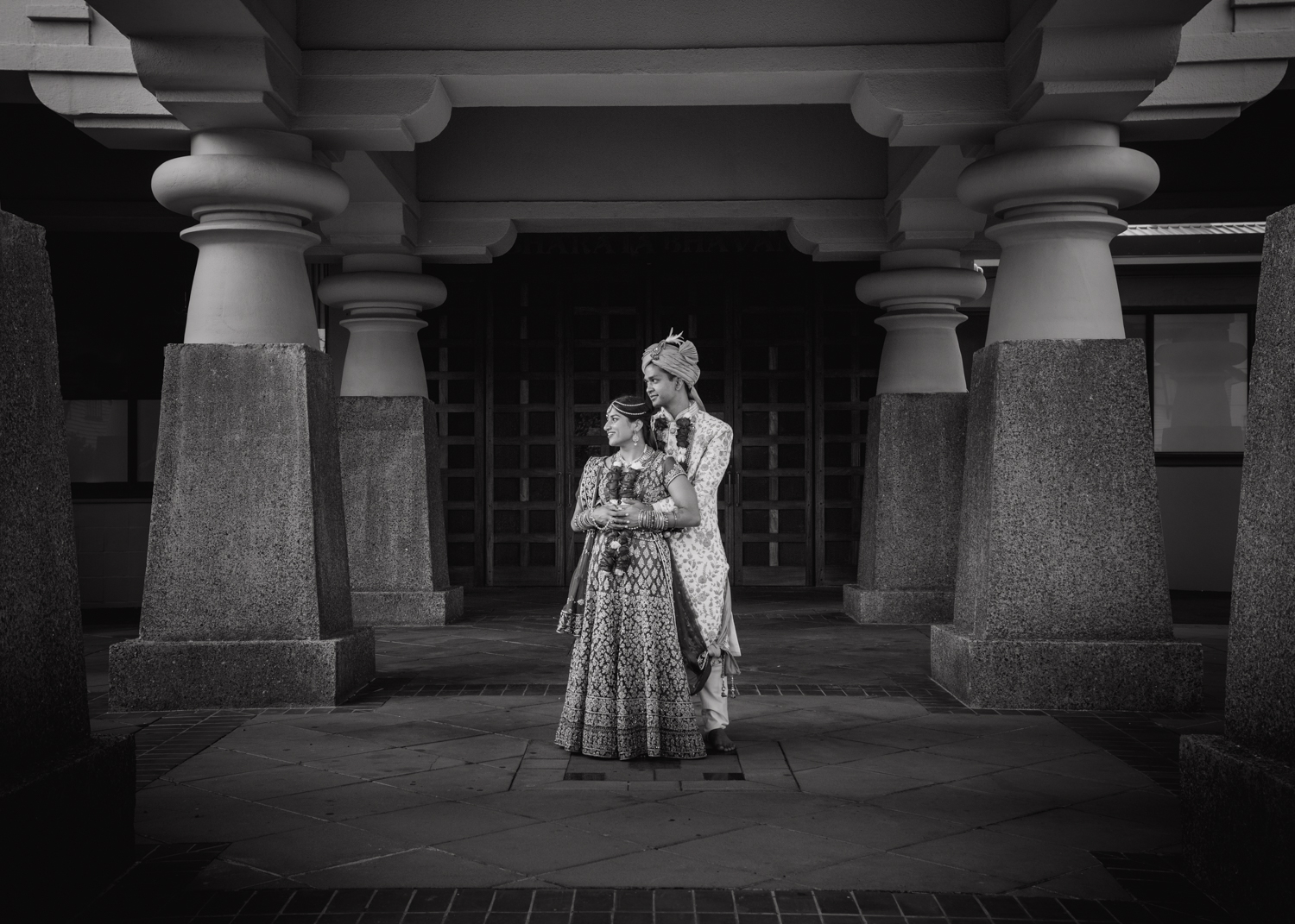 A Bride and Groom photographed in a creative and edgy way during a traditional Indian wedding in Wellington, New Zealand. Their wedding was at the Wellington Indian Association Hall in Kilbirnie. Photographed by Mala Photography, an Auckland based wedding photographer that has a lot of experience photographing Indian weddings in Auckland, Wellington, Hamilton, Queenstown and New Zealand wide.