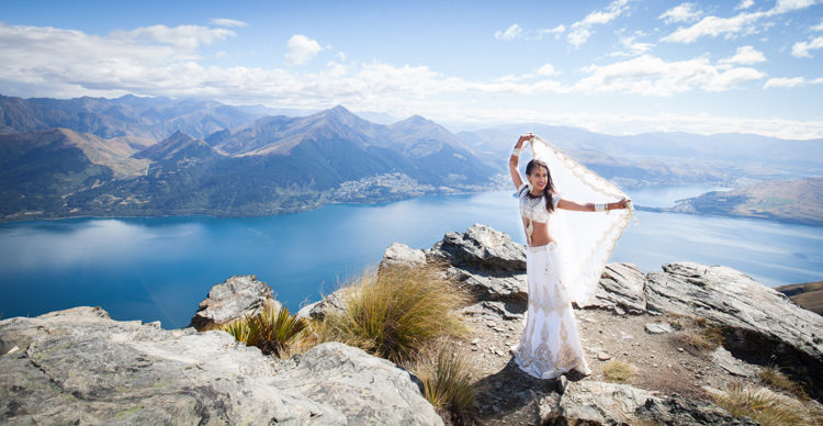 A wedding photo of a Bride taken at Cecil Ledge in Queenstown, New Zealand. Photo credit - Mala Photgraphy