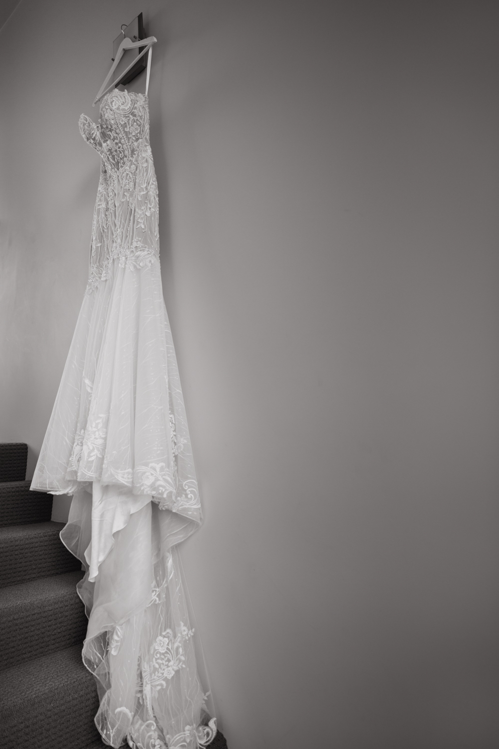 An artistic image of a Bride's dress taken by Mala Photography, an Auckland based wedding photographer. The wedding was at Markovina Vineyard Estate In Kumeu, Auckland.