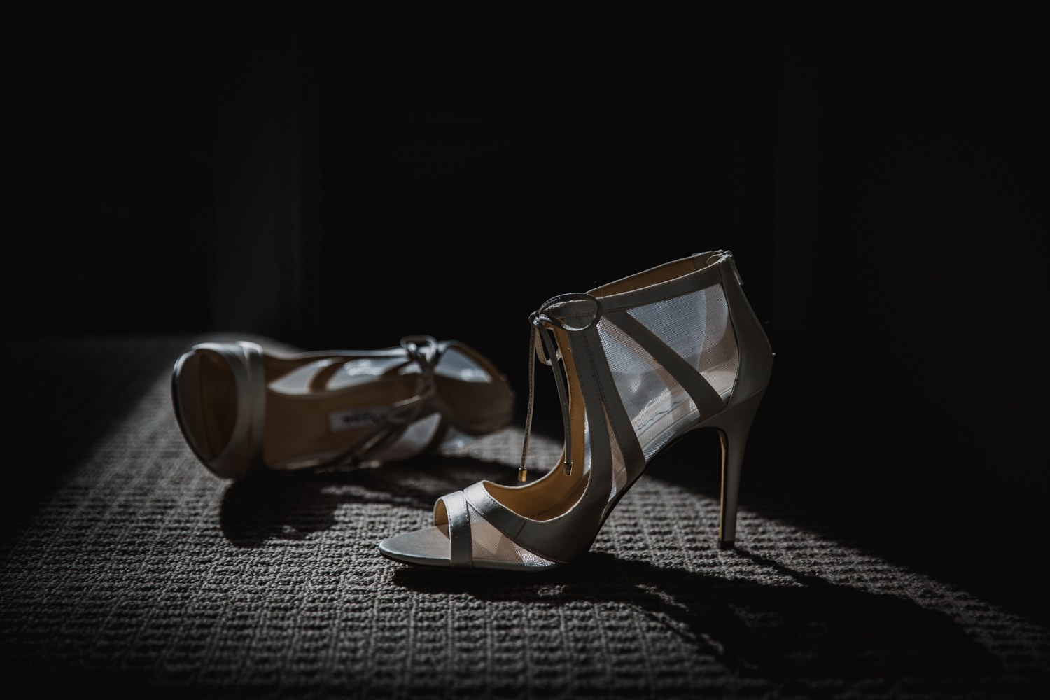 An artistic image of a Bride's shoes taken by Mala Photography, an Auckland based wedding photographer. The wedding was at Markovina Vineyard Estate In Kumeu, Auckland.