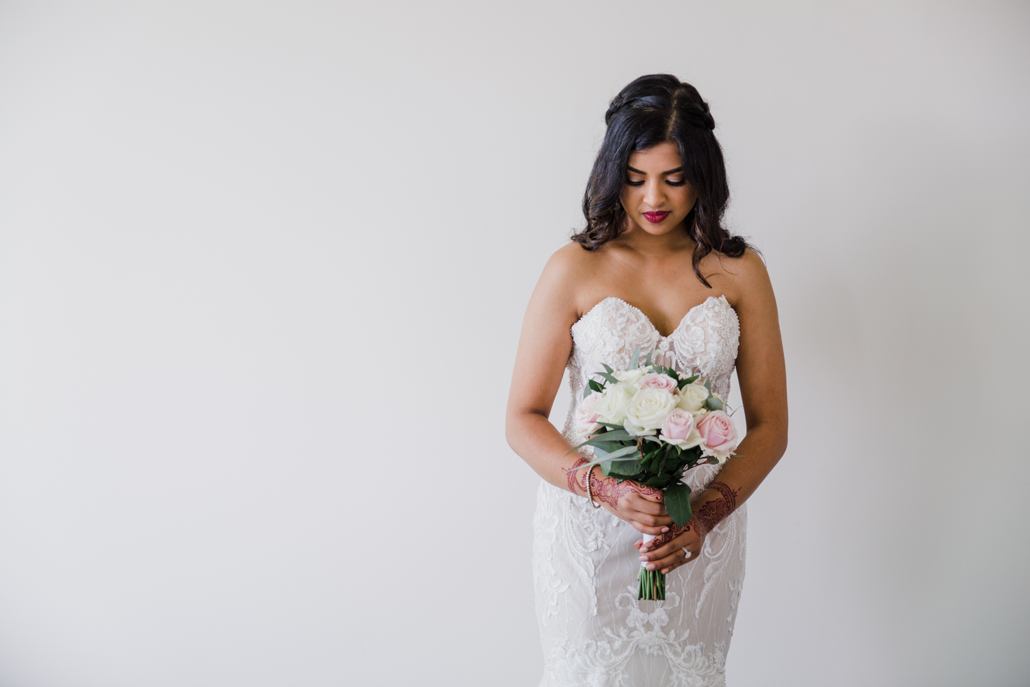A stunning bridal portrait of a Bride taken just before leaving home for the wedding. This image was taken by Mala Photography, an Auckland based wedding photographer. The wedding was at Markovina Vineyard Estate In Kumeu, Auckland.