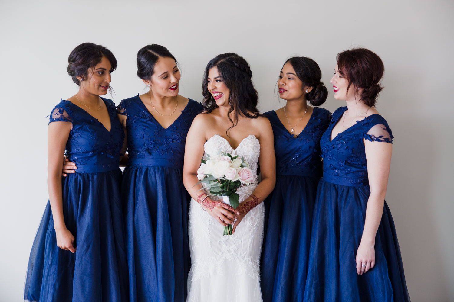 A stunning bridal portrait of a Bride and her Bride's maids taken just before leaving home for the wedding. This image was taken by Mala Photography, an Auckland based wedding photographer. The wedding was at Markovina Vineyard Estate In Kumeu, Auckland.