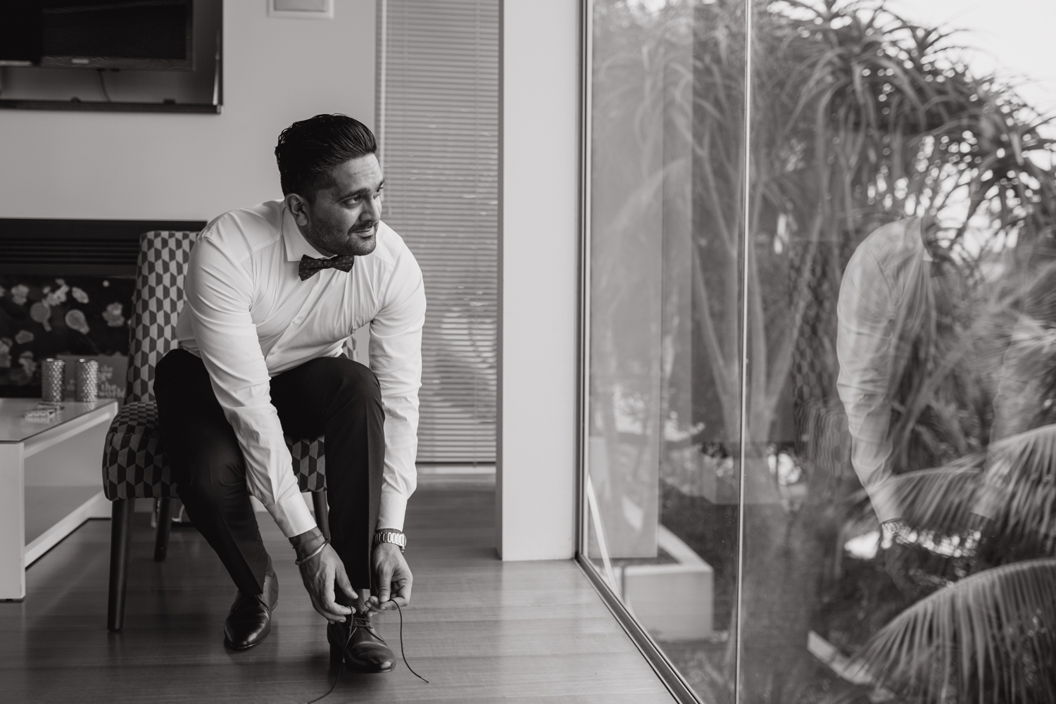 Groom getting ready for his wedding. This image was taken by Mala Photography, an Auckland based wedding photographer. The wedding was at Markovina Vineyard Estate In Kumeu, Auckland.