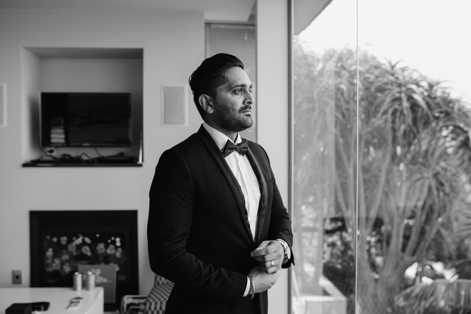 Groom getting ready for his wedding. This image was taken by Mala Photography, an Auckland based wedding photographer. The wedding was at Markovina Vineyard Estate In Kumeu, Auckland