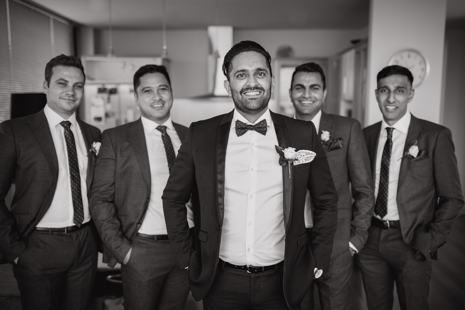 Groom and his groom's men. Groom getting ready for his wedding. This image was taken by Mala Photography, an Auckland based wedding photographer. The wedding was at Markovina Vineyard Estate In Kumeu, Auckland