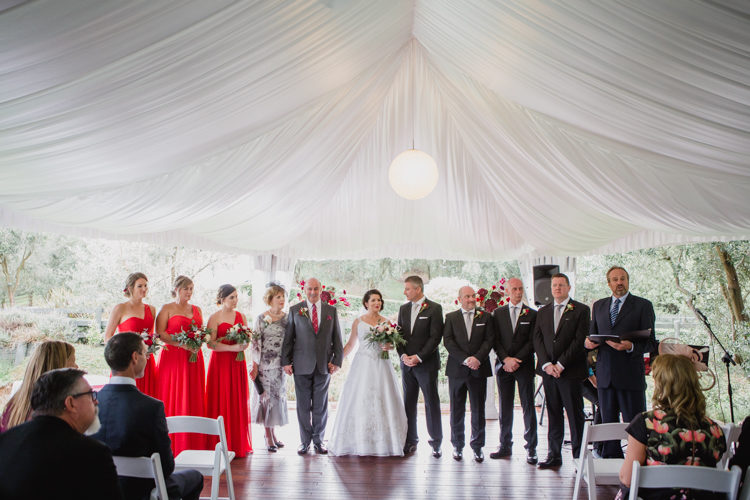 A wedding photo taken during a wedding ceremony at the Bracu Pavilion at the Simunovich Olive Estate in Rama Rama, near Auckland. This wedding photo was taken mb a wedding photographer in Auckland, named Mala Photography.