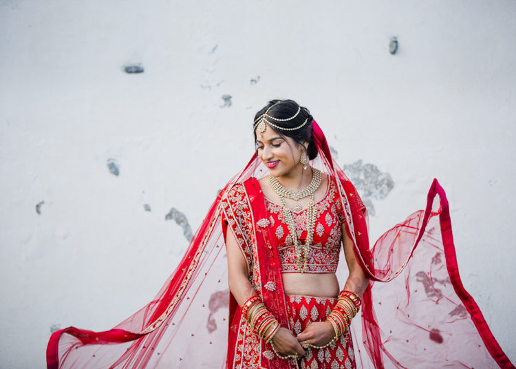 A photo of a Bride. She has been photographed in and artistic and unique way. This photo was taken by Mala Photography, an Auckland based wedding photographer that is known for her unique wedding photos.