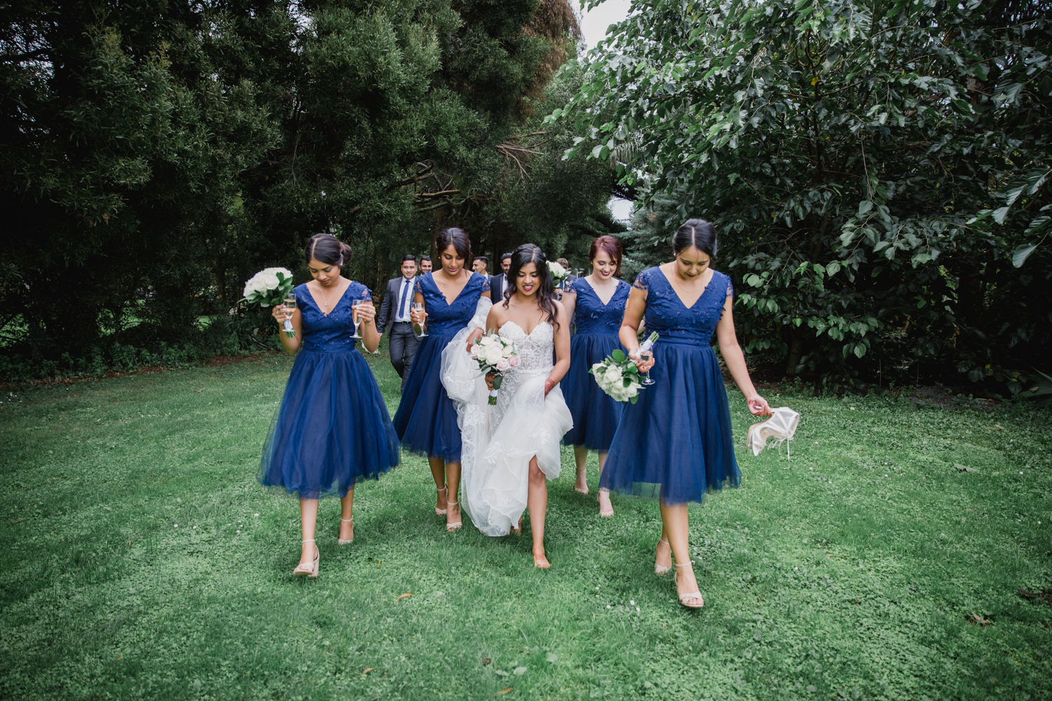 Bride and groom and their bridal party. This image was taken by Mala Photography, an Auckland based wedding photographer. The wedding was at Markovina Vineyard Estate In Kumeu, Auckland
