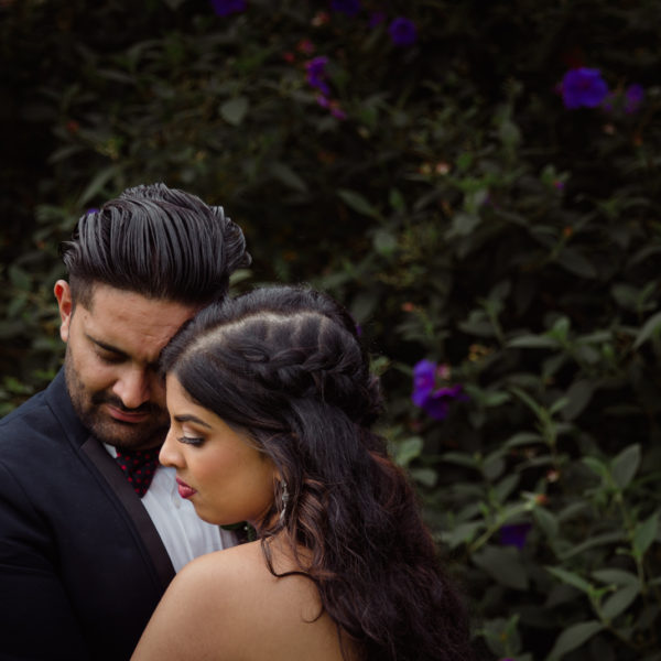 An artistic wedding photo of a Bride and Groom taken by Mala Photography, an Auckland based wedding photographer. The wedding was at Markovina Vineyard Estate In Kumeu, Auckland.