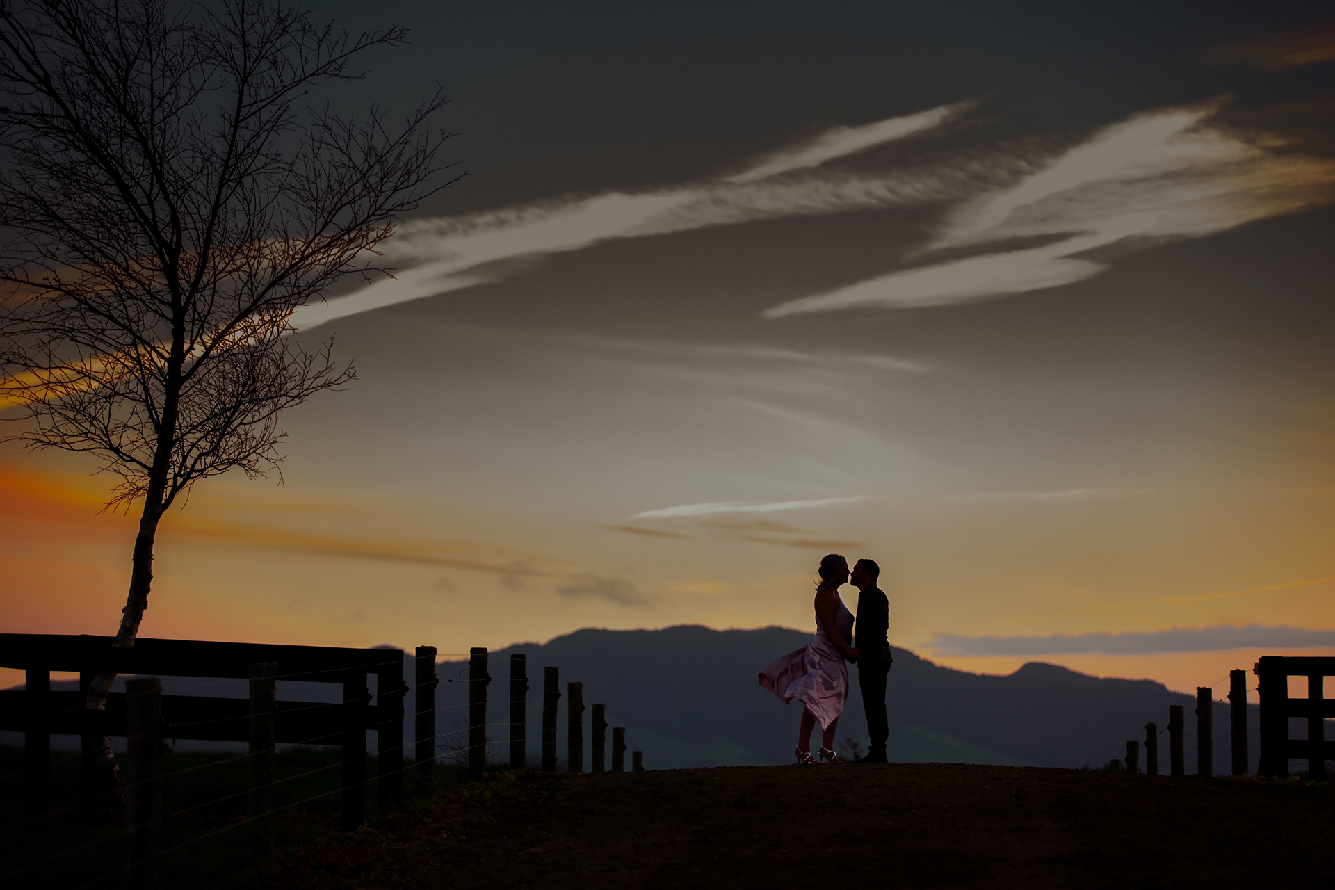 A wedding photo taken at sunset of a Bride and Groom spending time together before heading into their wedding reception. This photo was taken by Mala Photography, an Auckland wedding photographer. This photo was taken at The Red Barn, a beautiful wedding venue near Auckland.