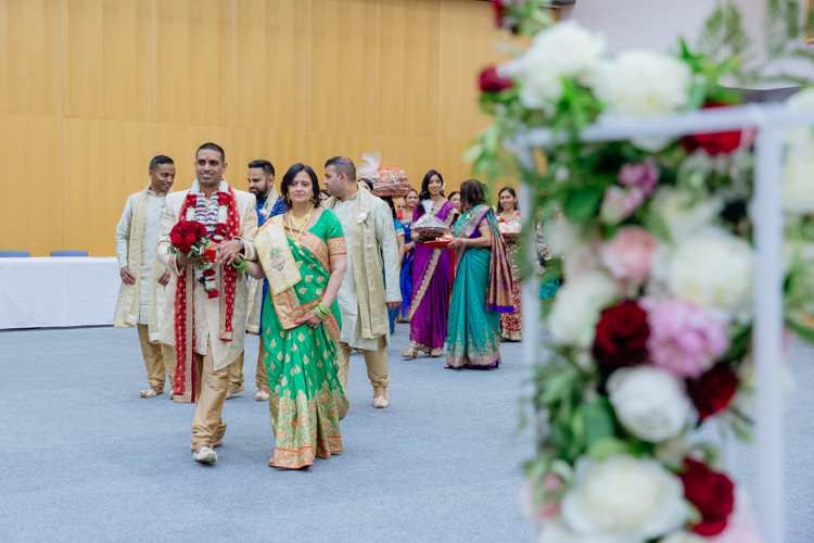A groom making his entrance at a traditional Indian wedding. Photo by Mala Photography, an Auckland based wedding photographer.